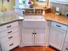 A Detail Of A Staggered Upper Cabinet Crown Treatment The Lower - Corner cabinet for farmhouse sink