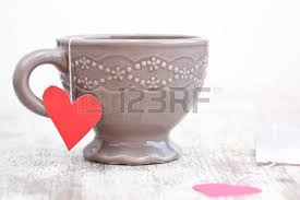 heart shaped tea bags cup with heart shaped tea bag stock photo picture and royalty