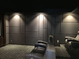 Unfinished Basement Ideas On A Budget Modern Home Theater Design Featuring A Geometric Acoustic Panel