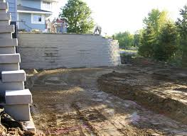 a modular block retaining wall reshapes a sloping backyard