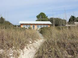 the beach house florida alligator point cottage rental back of the house from the beach