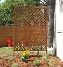Backyard Privacy Screens Trellis Block The View Of The Neighbor U0027s House With Vertical Trellises And