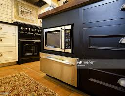 microwave built into kitchen island stock photo getty images
