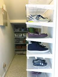 simply done the ultimate under stairs closet simply organized the ultimate organized under stairs closet by simply organized