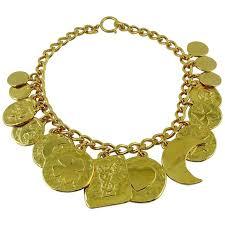charm necklace vintage images Yves saint laurent vintage gold toned iconic multi charm necklace jpg