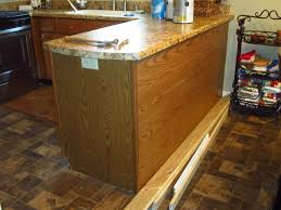 how to install peninsula kitchen cabinets how to cover wood paneling on kitchen cabinets home