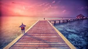 beaches paradise pier purple clouds holidays bungalow sea