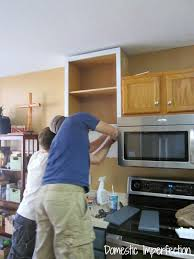 how to add a shelf to a cabinet how to raise your kitchen cabinets to the ceiling domestic