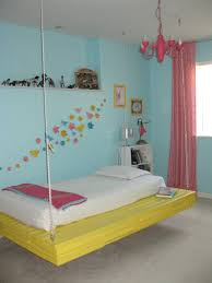 hanging platform bed with yellow platform and pink curtains and hanging platform bed with yellow platform and pink curtains and white bookshelf