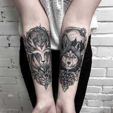 engraving style black ink forearm of deer with wolf and