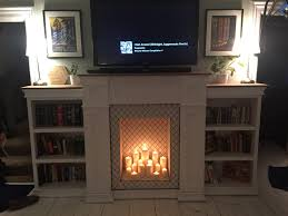 faux fireplace with bookcases and hidden storage album on imgur