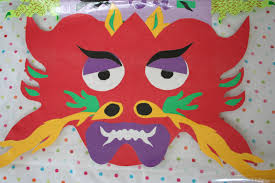 pink and green mama cut paper dragons for chinese new year