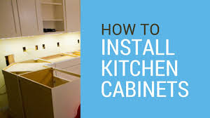 How To Install Upper Kitchen Cabinets How To Install Kitchen Cabinets Youtube