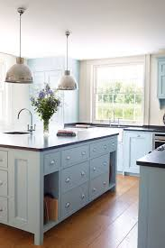 stone countertops light blue kitchen cabinets lighting flooring
