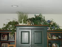 Living Room Armoire Decorating Above Tv Armoire Joyful Daisy