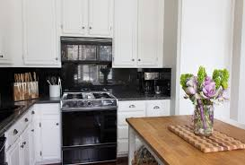 eunice s serene san francisco kitchen kitchn her kitchen is as unfussy and serene as the rest of the home a dark backsplash creates drama but the white cabinets and the butcher block island keep it