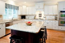 what color granite with white cabinets and dark wood floors new venetian gold granite countertops white cabinets dark island