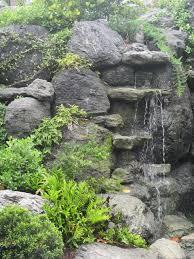Volcanic Rock Garden Volcanic Rock Waterfalls With Tropical Plantings Asian Garden