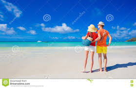 Tropical Clothes For Travel Couple In Bright Clothes On A Tropical Beach At Praslin