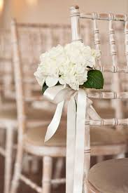 chagne satin ribbon end of aisle flowers might be best to change the green leaves to
