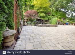 backyard garden asian inspired paver patio with pagoda pond bronze