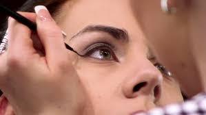 makeup professional professional makeup artist applying makeup to a model sequence