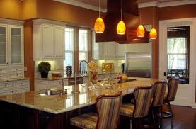 hanging pendant lights kitchen island lighting luma pendant lights with an orange hue complement the