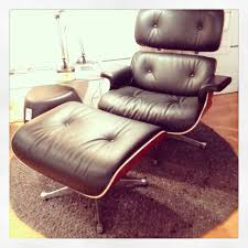 the original eames lounge chair and ottoman from vitra in black