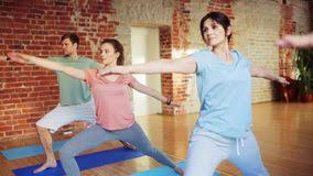 group of people making yoga exercises in gym stock video video