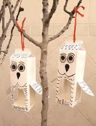 recycled milk carton bird feeder shaped like an owl bird feeder