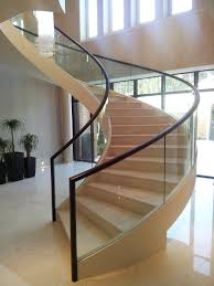 fabricated mild steel helical staircase with structural glass