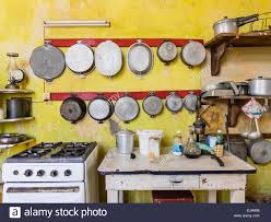 a view of the stove and work table next to it and many pot and