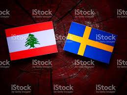 Libanese Flag Lebanese Flag With Swedish Flag On A Tree Stump Isolated Stock