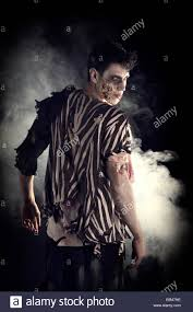 halloween photo background male zombie standing on black background turning around looking