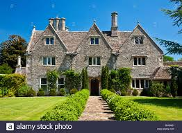 country mansion a grand country manor house in summer stock photo