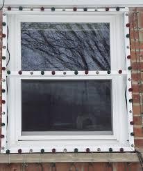 hanging christmas lights around windows bazillion lights window frames