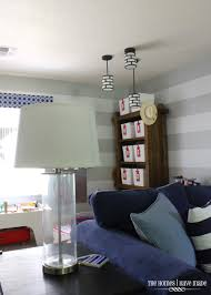 ideas for lighting a rental the homes i have made yes we installed pendant lights into our rental the playroom side of this great room always felt so dark and i really wanted hanging lights instead of