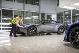 bmw ceo faint inspecting the first aston martin db11s with ceo andy palmer autocar