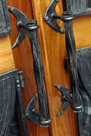 hand crafted custom hand forged iron door handles by arc iron