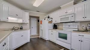 what hardware for white kitchen cabinets kitchen with white cabinets and rubbed bronze hardware