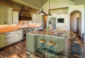 marble countertops sage green kitchen cabinets lighting flooring