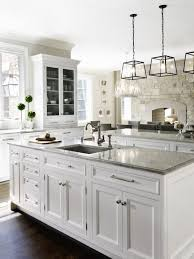The Kitchen Above Utilizes White Shaker Kitchen Cabinets Which Are - Shaker white kitchen cabinets