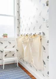 laundry room hampers hanging from wall hooks transitional