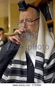 small shofar religious blows a small shofar during services prior to