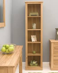 natural stained maple wood tall thin narrow bookcase placed on