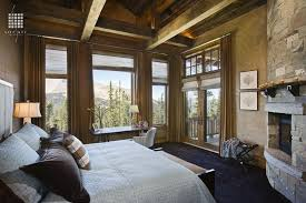 rustic master bedroom with interior brick by locati architects
