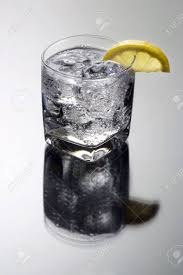 vodka soda club soda or vodka gin and tonic mixed drink with lemon slice