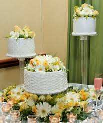 3 separate tier round wedding cake with design and flowers cakes