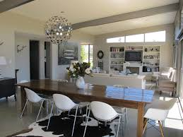 dining area rugs should you put a rug under a dining room table interior black and white cowhide rug under long rectangle brown wooden dining table connected by white