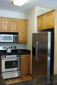 amusing wooden kitchen cabinet escorted by black marble